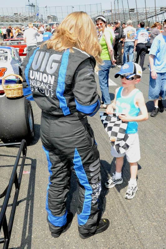 Renee signs autographs for a young fan during Stafford's annual Spring Sizzler event. Howie Hodge Photo.