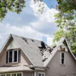 Home with severely damaged roof