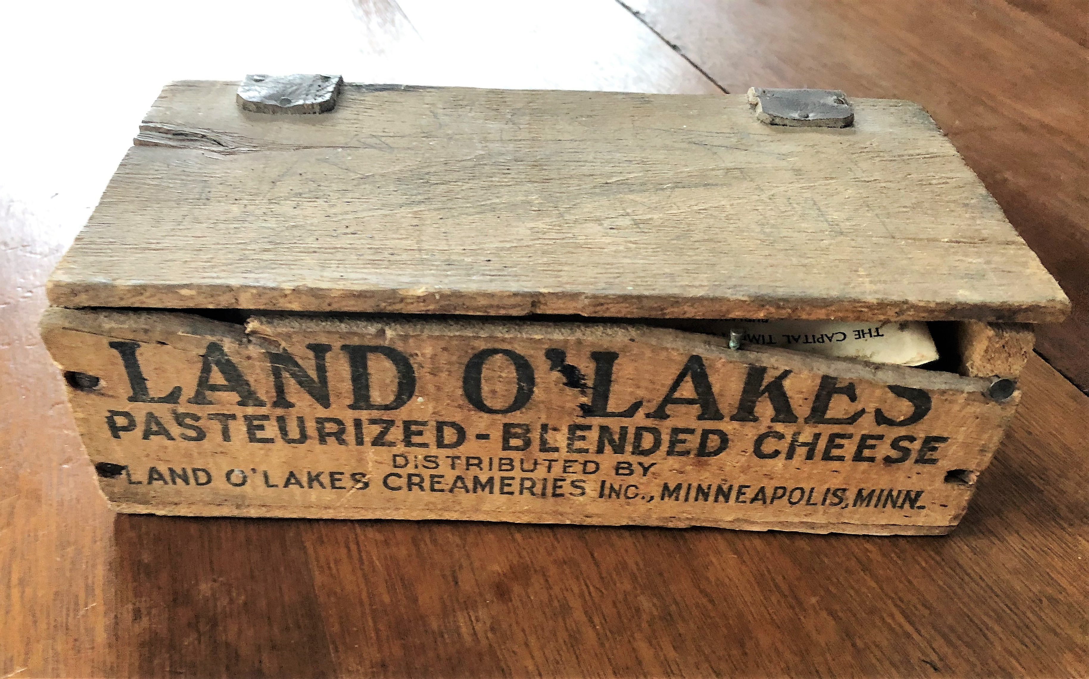 Many treasures were found in this old cheese box.