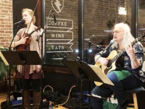 Joanna Johnson, left, and her mother Deb perform.
