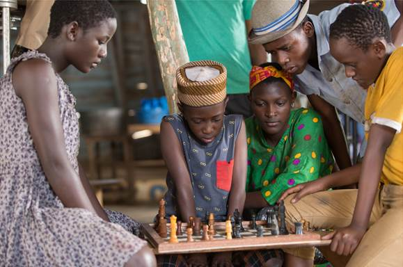 Phiona learning chess