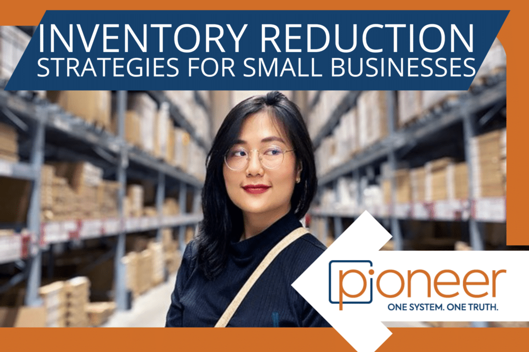 inventory reduction strategy - woman wearing glasses and standing in warehouse