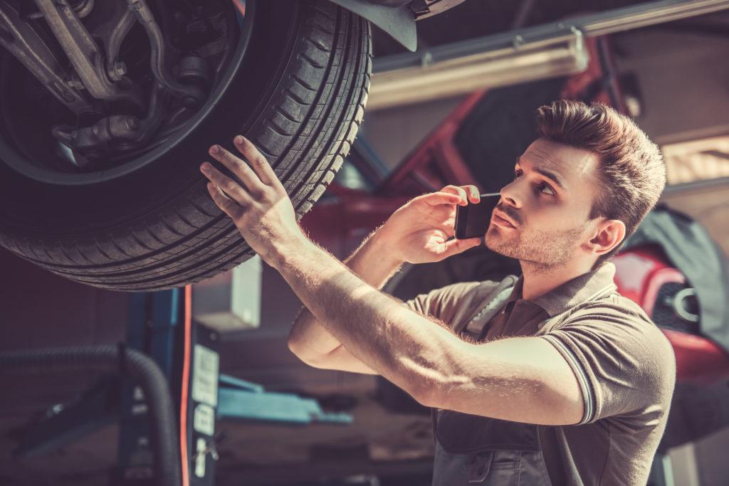 technician working on a car