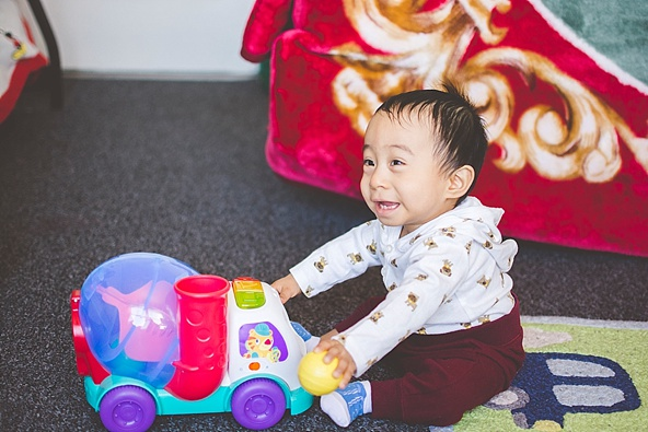 one year old boy with toys