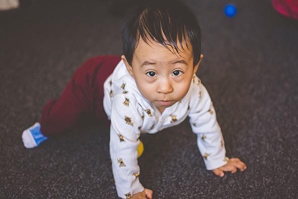 one year old boy crawling