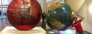 man holding up a globe