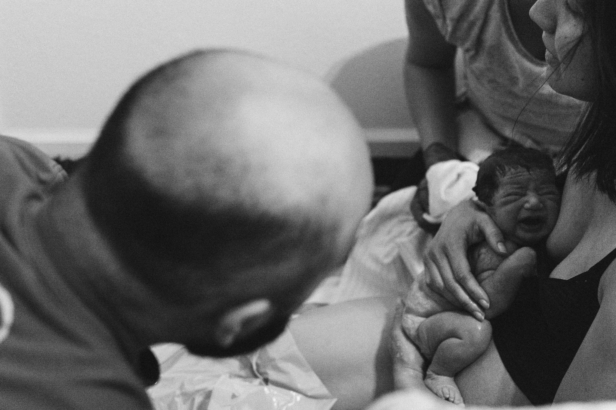 dad viewing newborn baby girl documentary birth photography