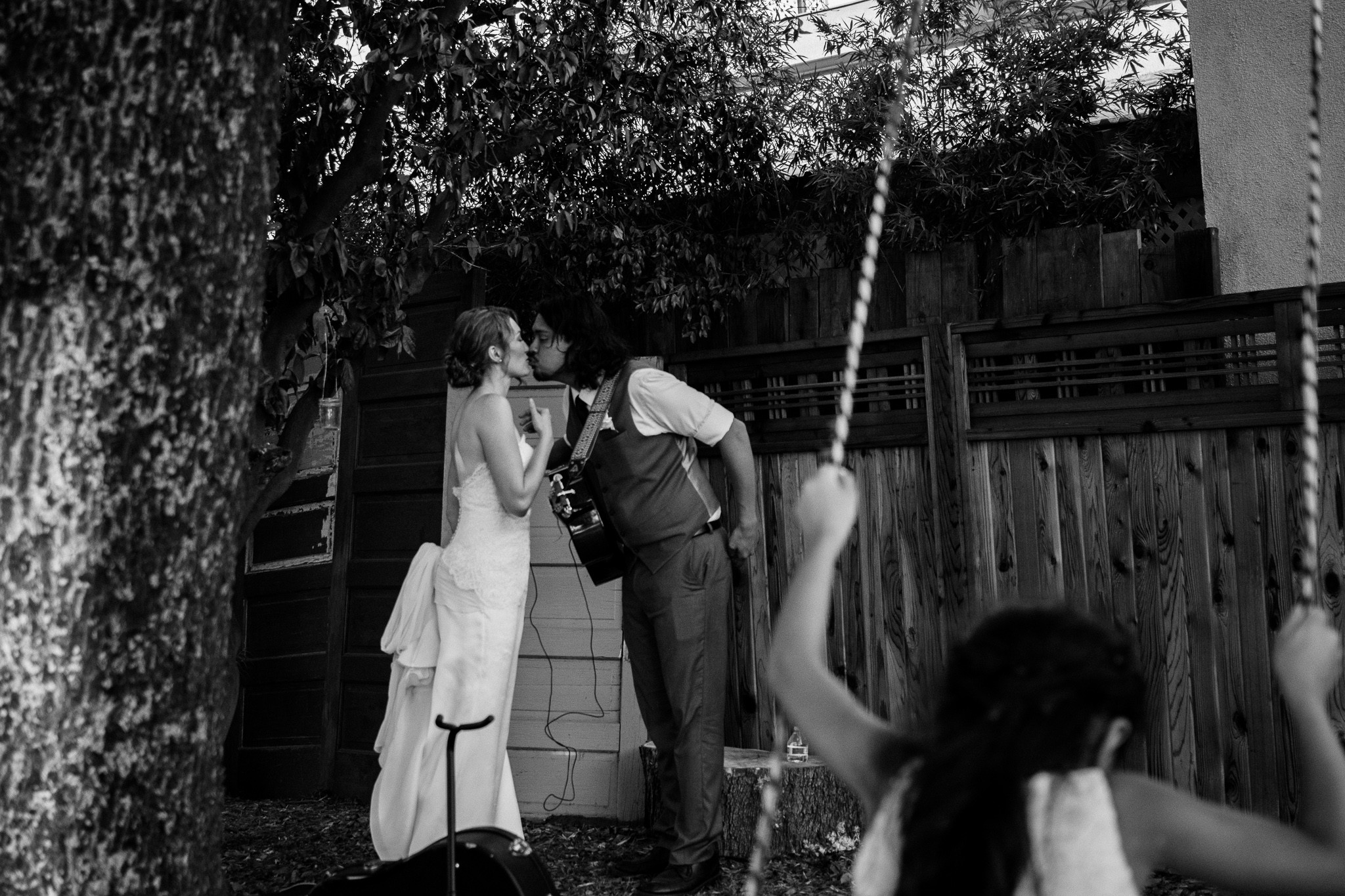 bride and groom kissing documentary family photography