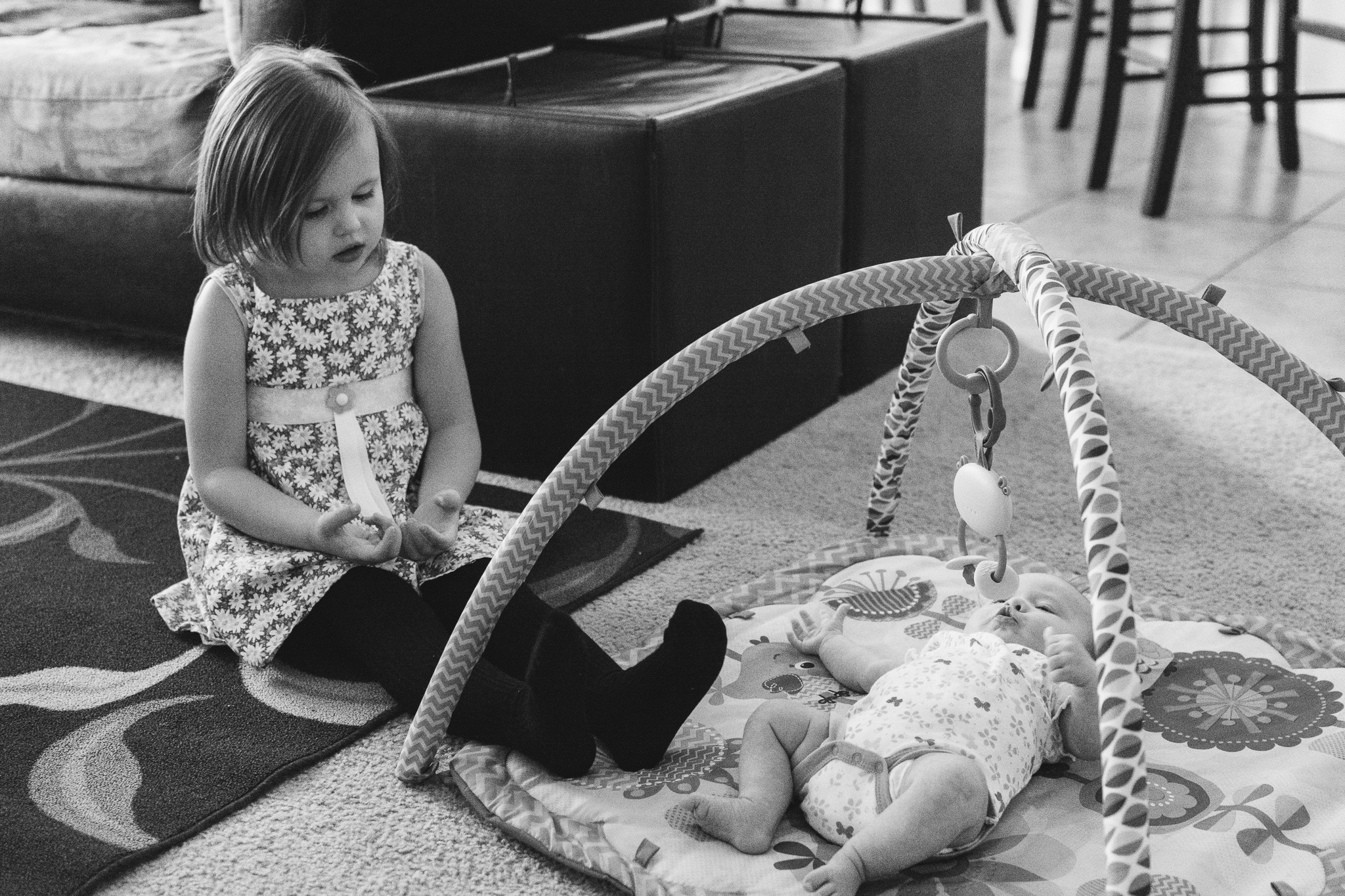 toddler girl with baby sister documentary family photography