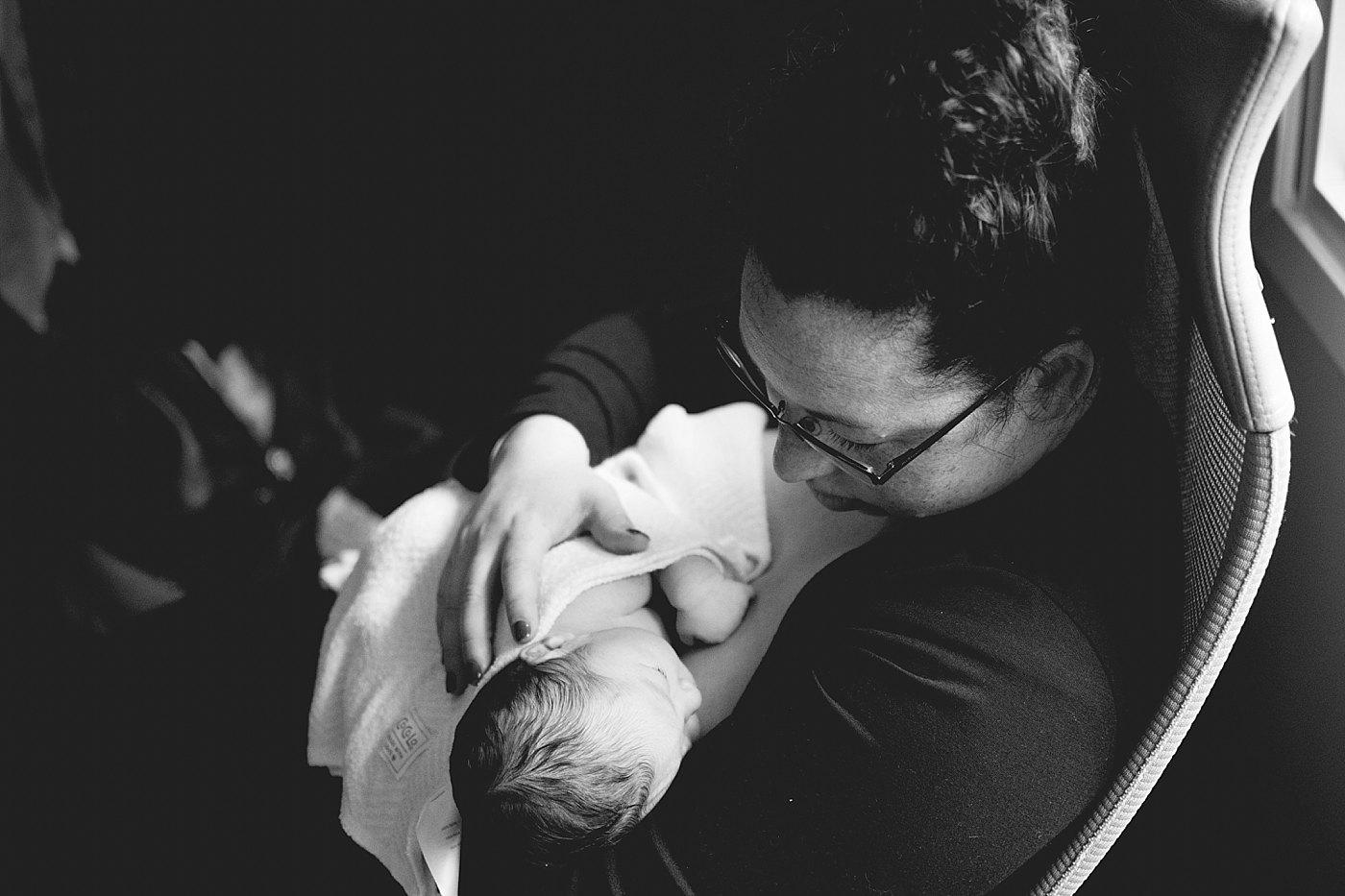mom nursing newborn captured grace by erin