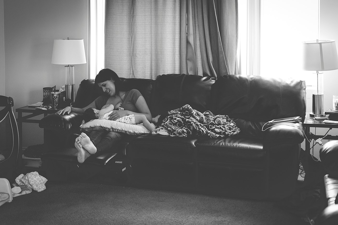 mom breastfeeding nursing baby captured grace by erin family photography