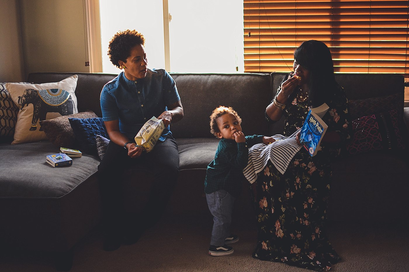 toddler boy eating popcorn with parents redlands family photographer