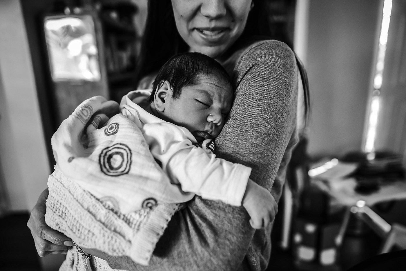 mom cuddling newborn son redlands newborn photographer