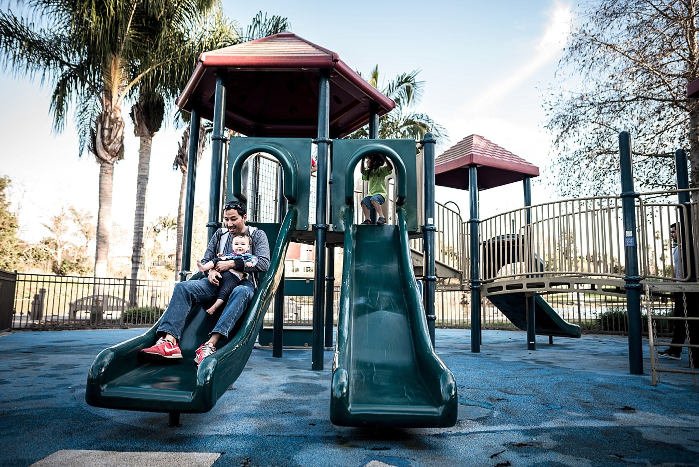 dad playing with daughter on slide playground redondo beach redlands family photography