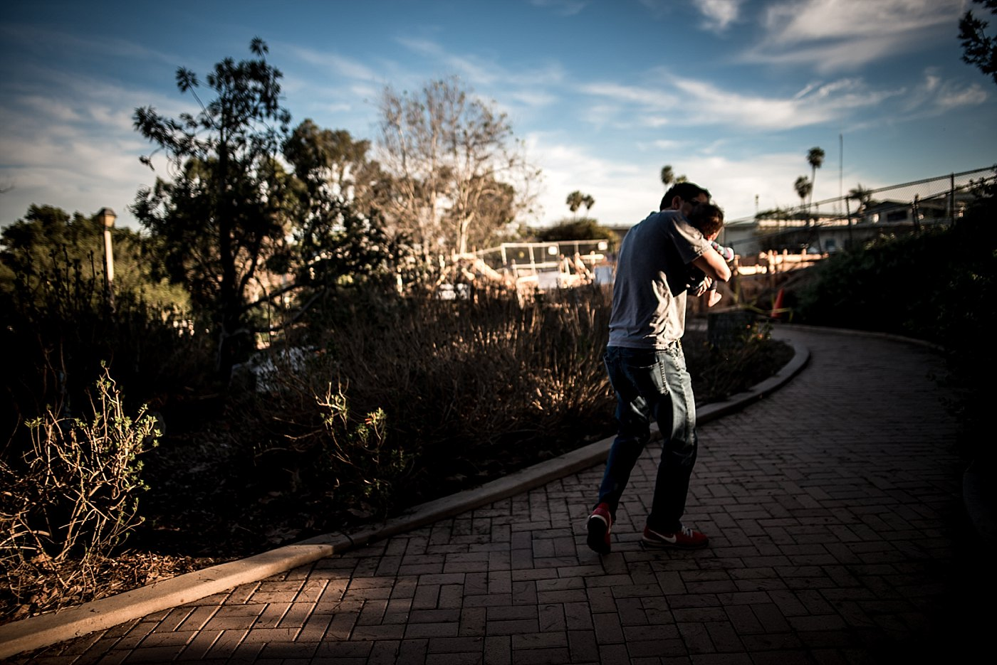 dad walking baby uphill redondo beach redlands family photography