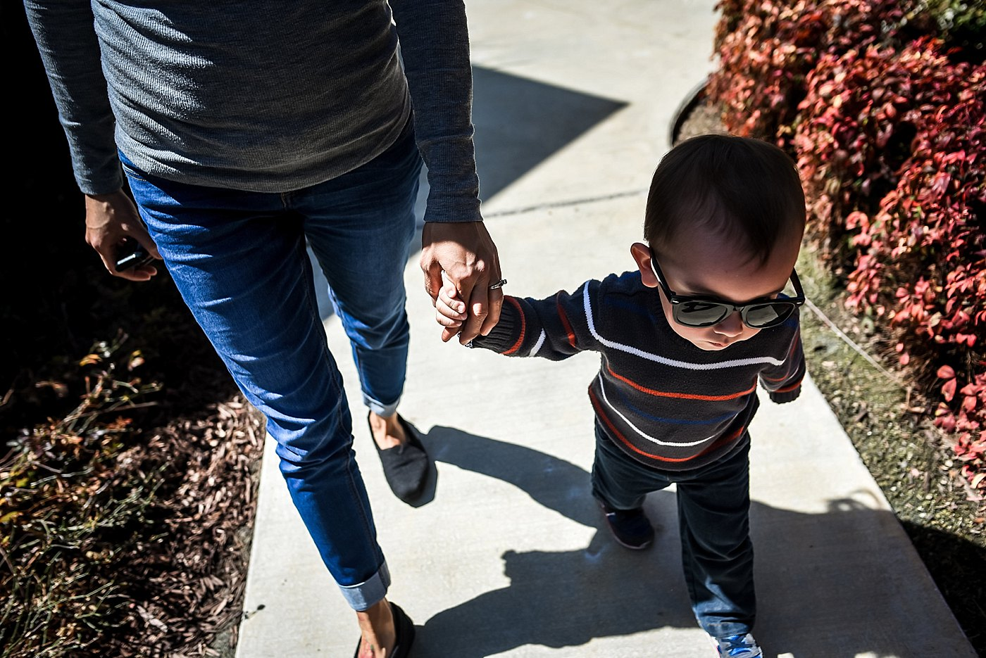 toddler holding moms hand walking day in the life redlands family photography