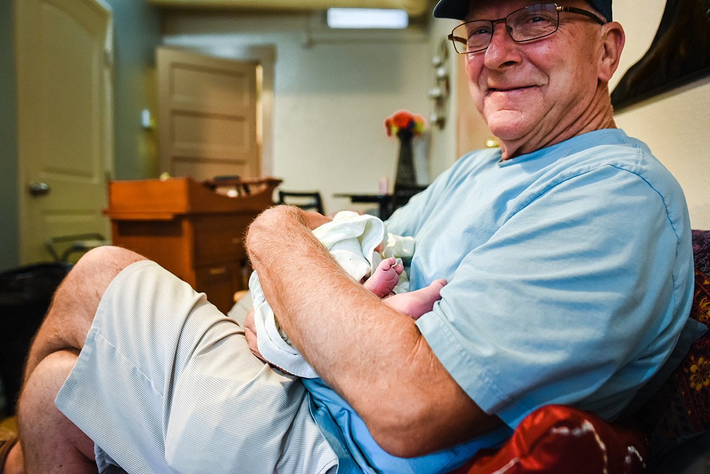 grandpa holds newborn Yucaipa birth photographer
