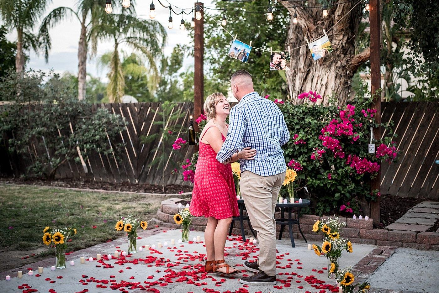 woman smiles after backyard proposal redlands family photographer