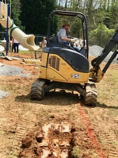 digging drainage for playground