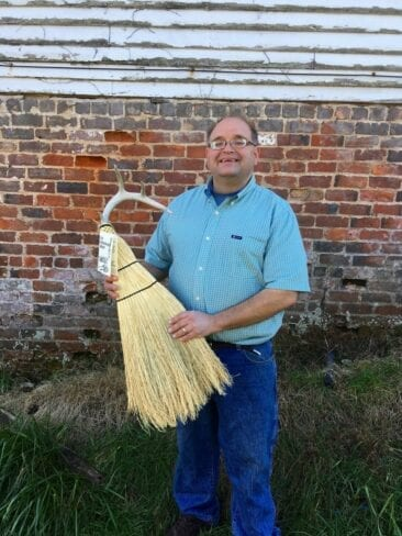 Marlow Gates of the Friendswood Broom in Big Sandy Mush holding antler hearth broom