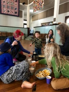 children and adults having popcorn snack at SMCC Playgroup