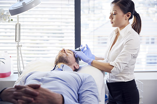 Man getting injections of PRP for hair loss