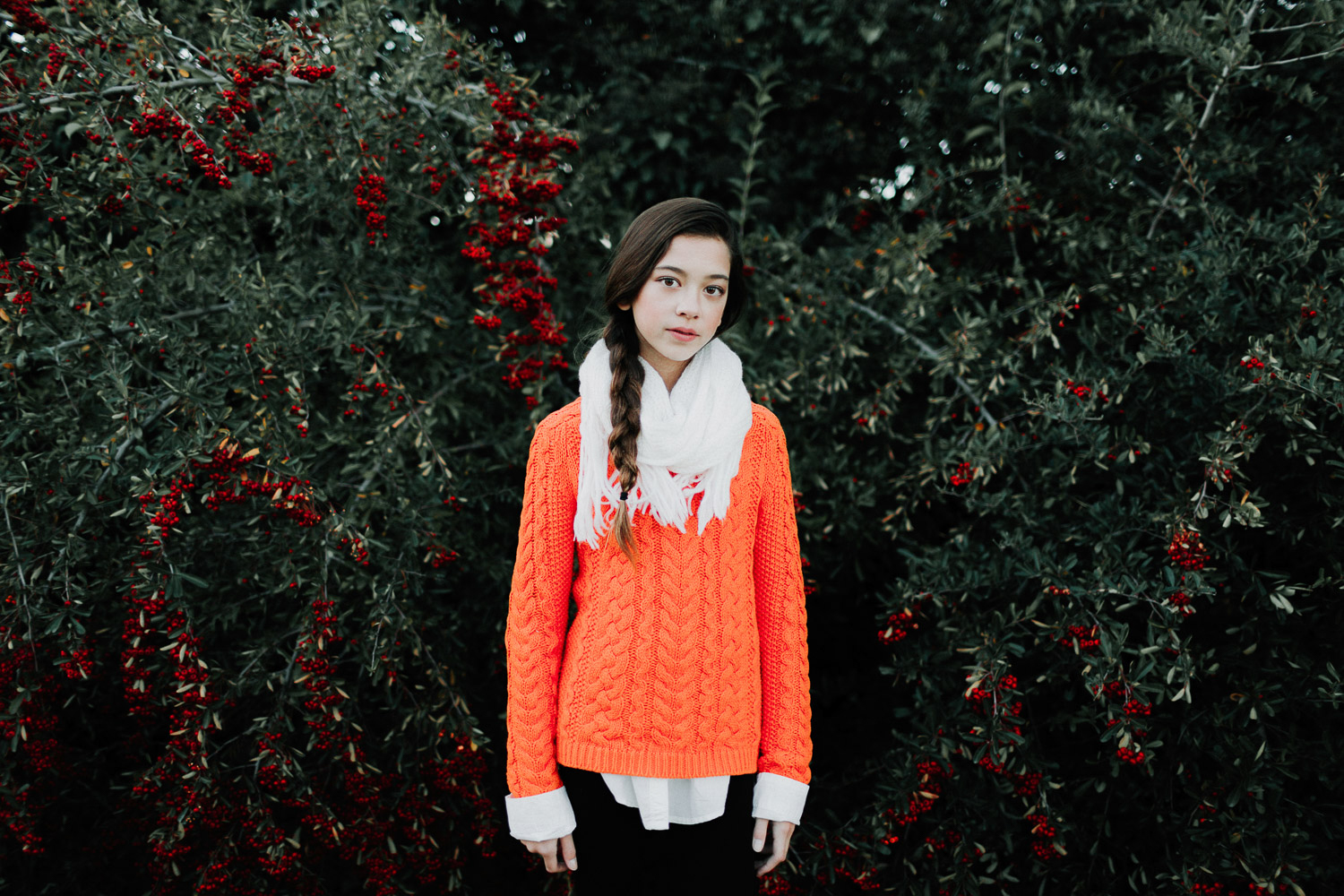 Image of a girl wearing an orange sweater