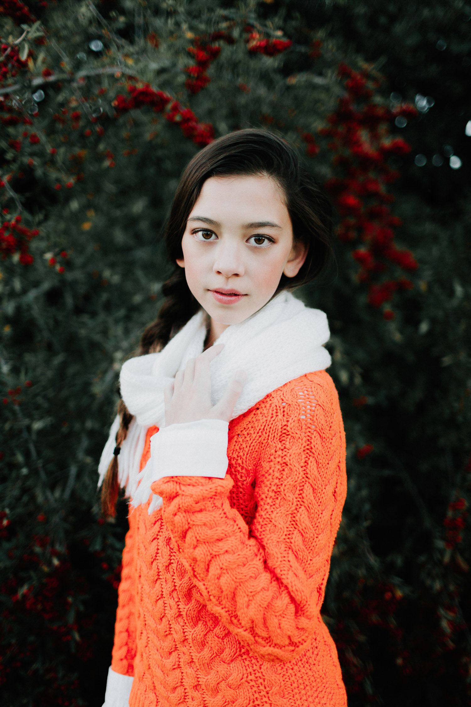 Image of orange sweater girl looking at camera