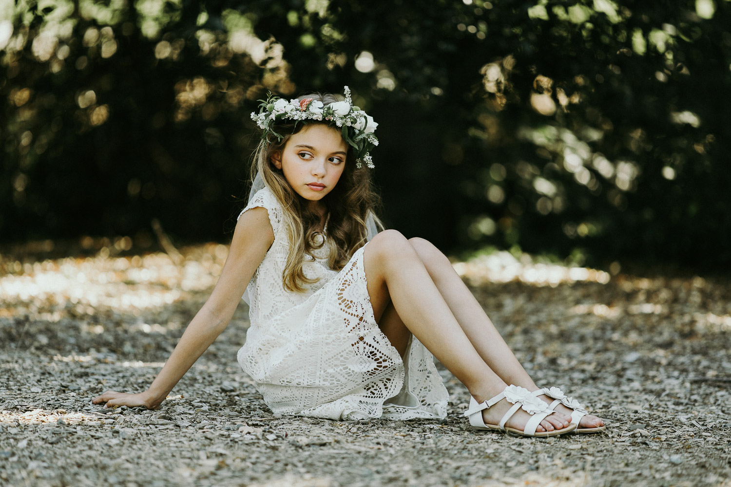 Image of a white dress girl sitting on the ground