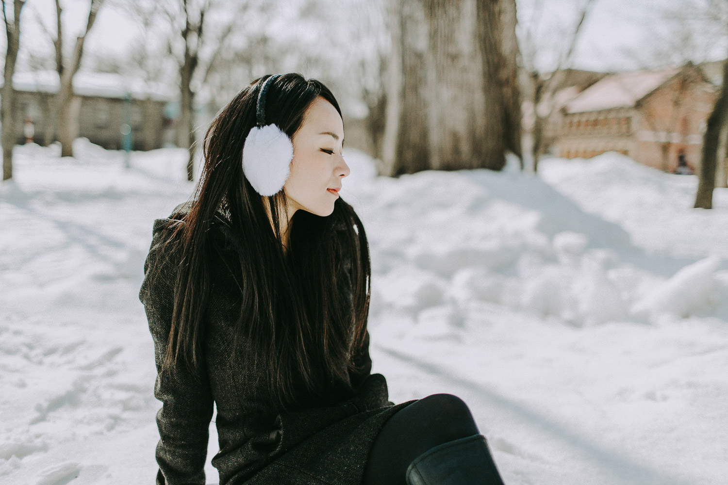 Image of a girl sits in the snow
