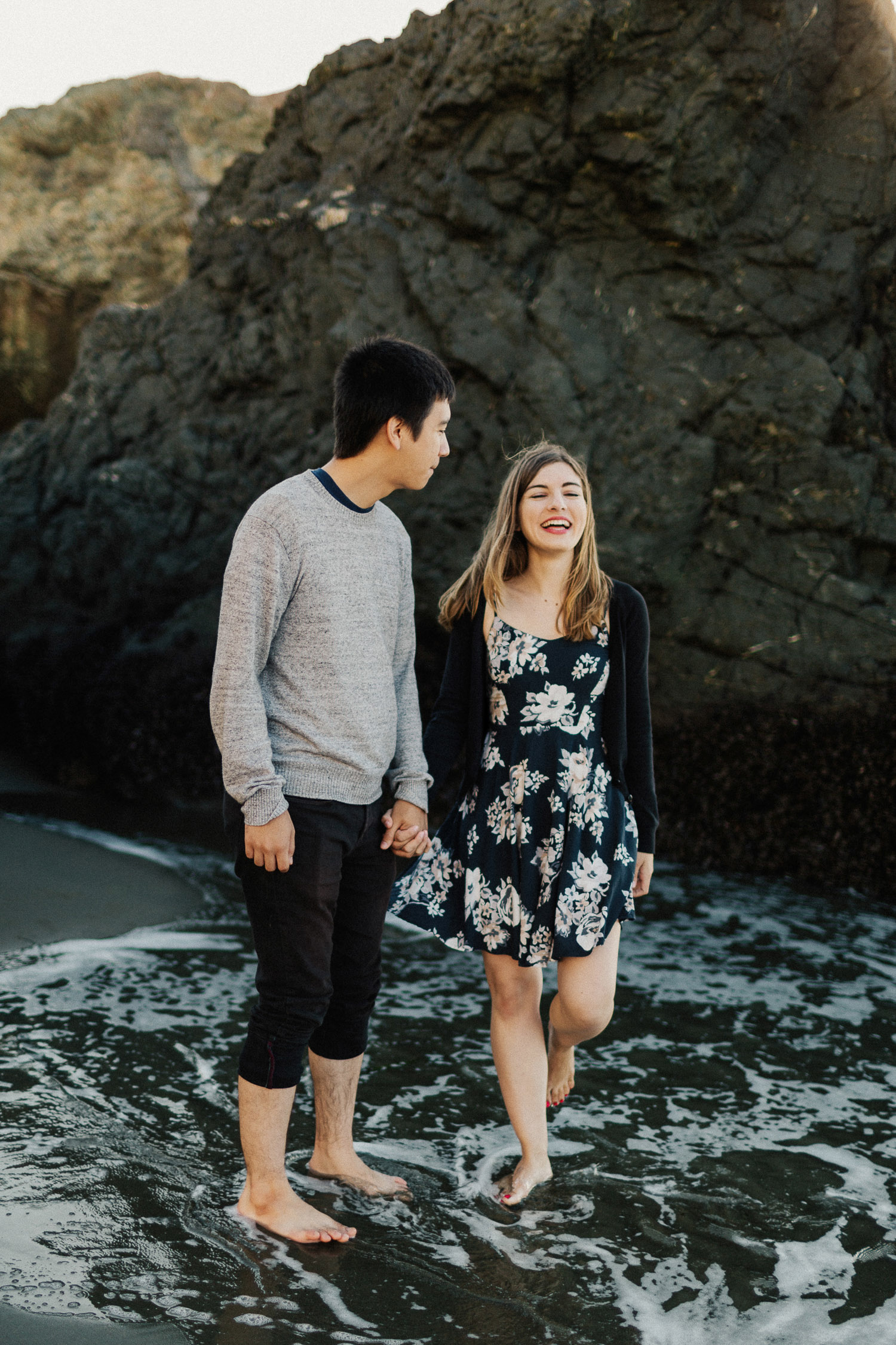 Image of couple hold hands together on beach