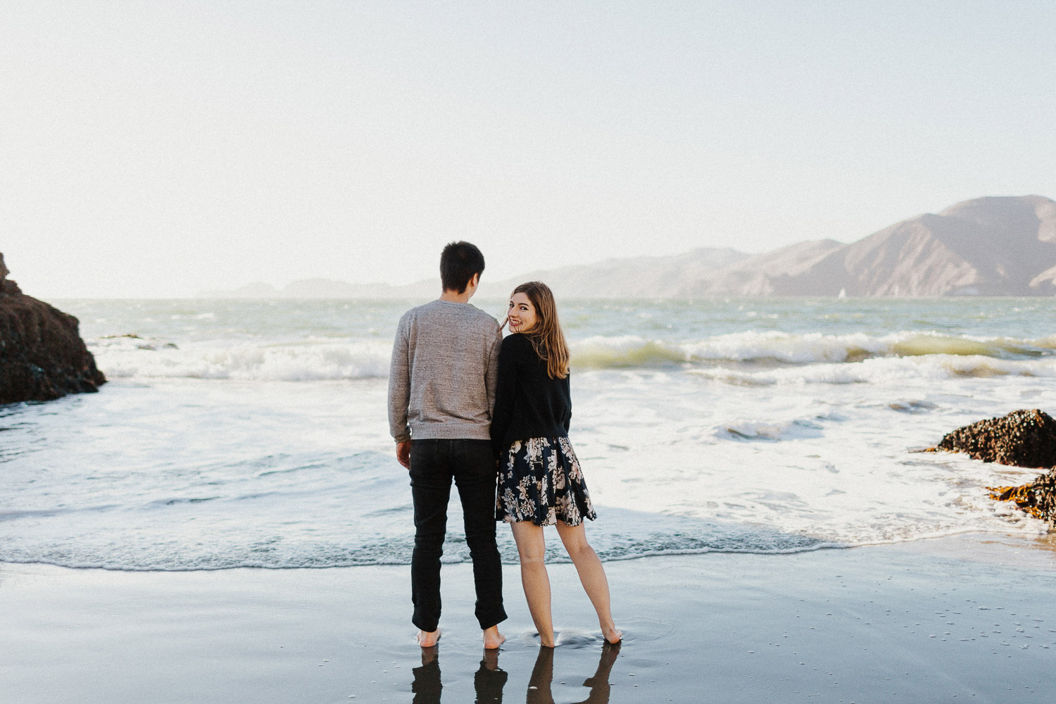 Image of couple stand together on beach
