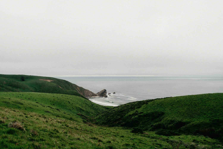 Image of green mountian next to ocean