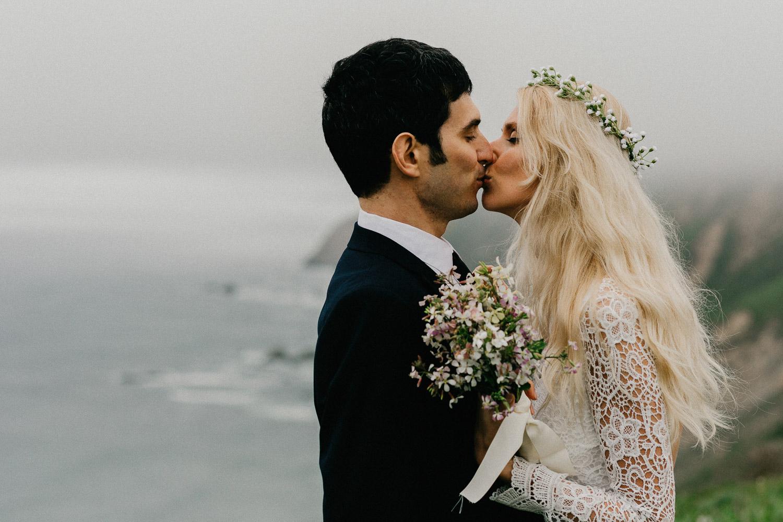 Image of bride kisses groom