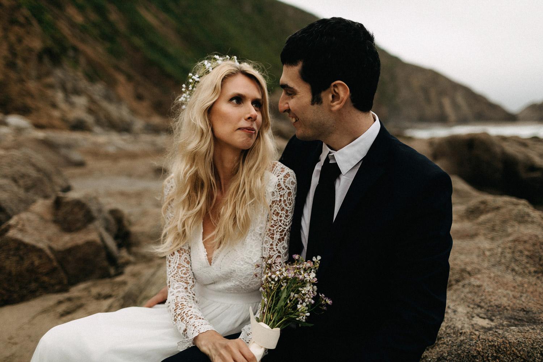 Image of bride looks at groom