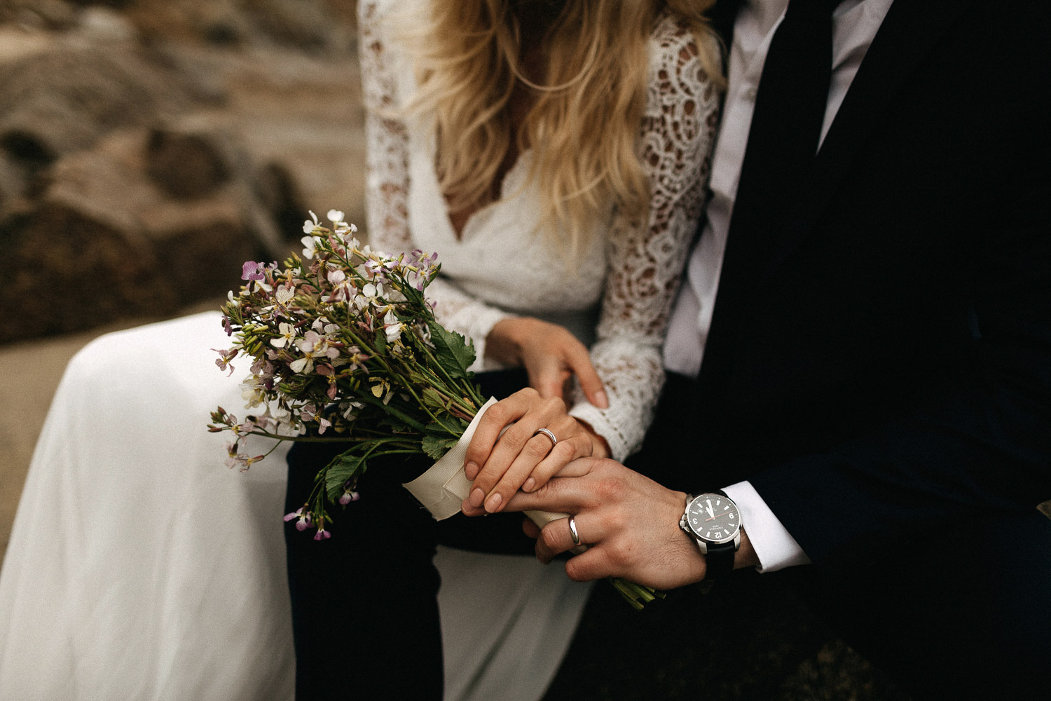 Image of wedding rings and wedding bouquet