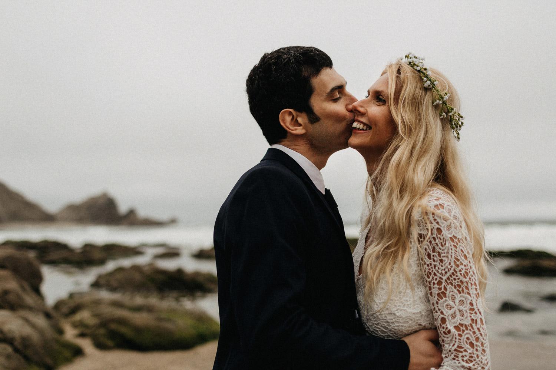 Image groom kisses bride on cheek