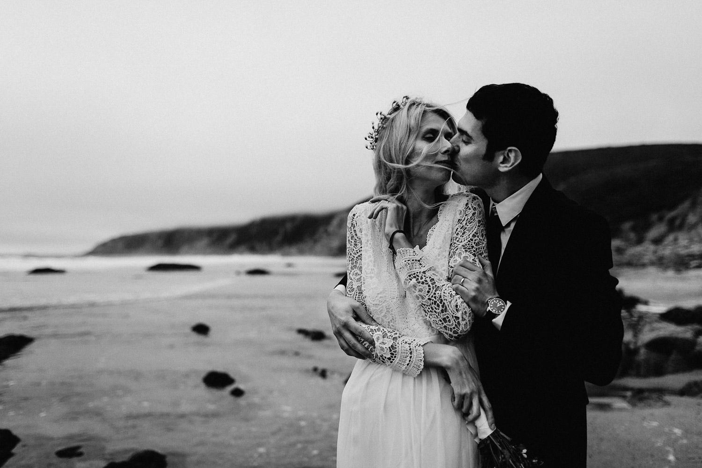 Black & White Image of groom kisses bride