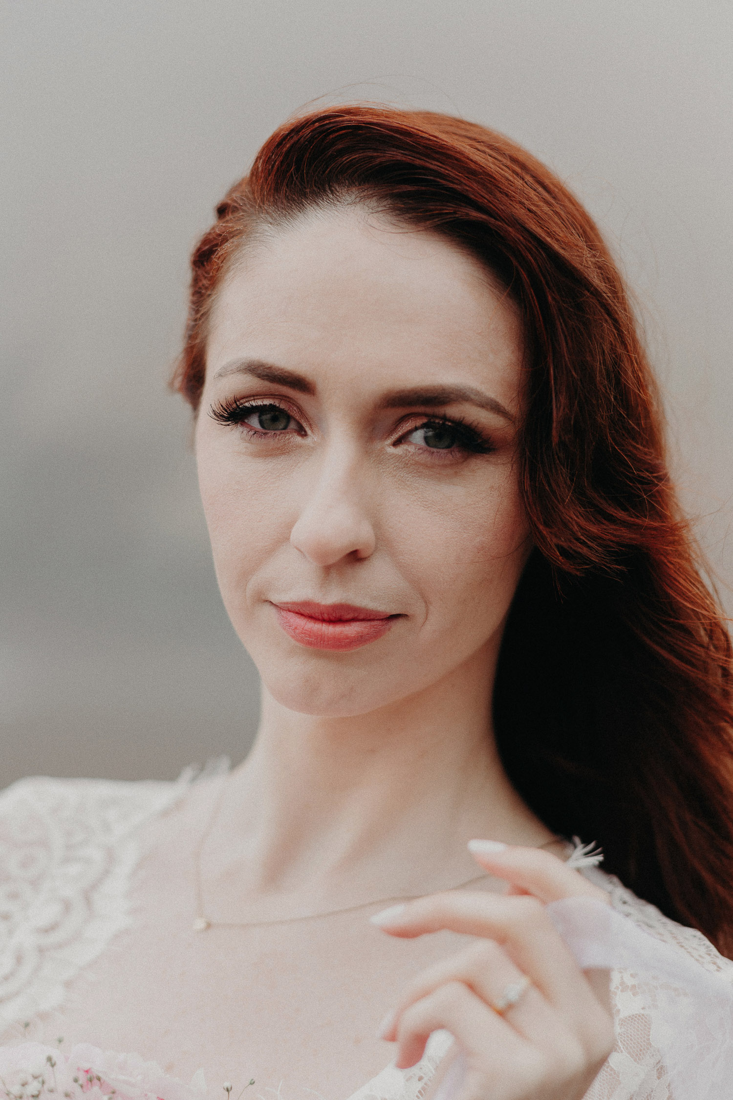 Image of red hair bride looks at the camera