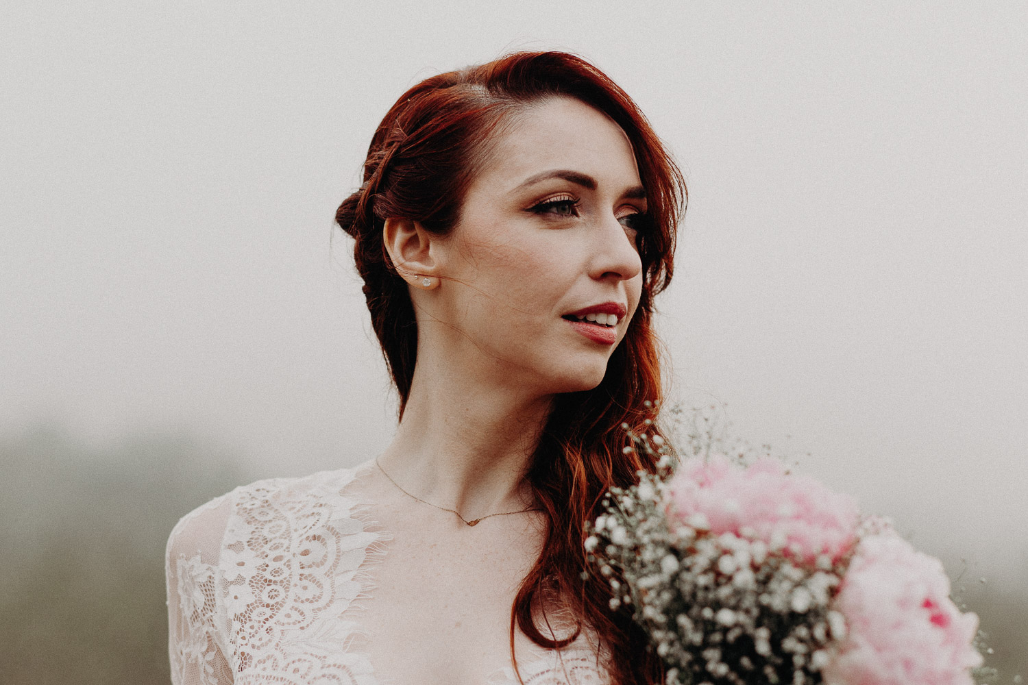 Image of red hair bride smiles to the right