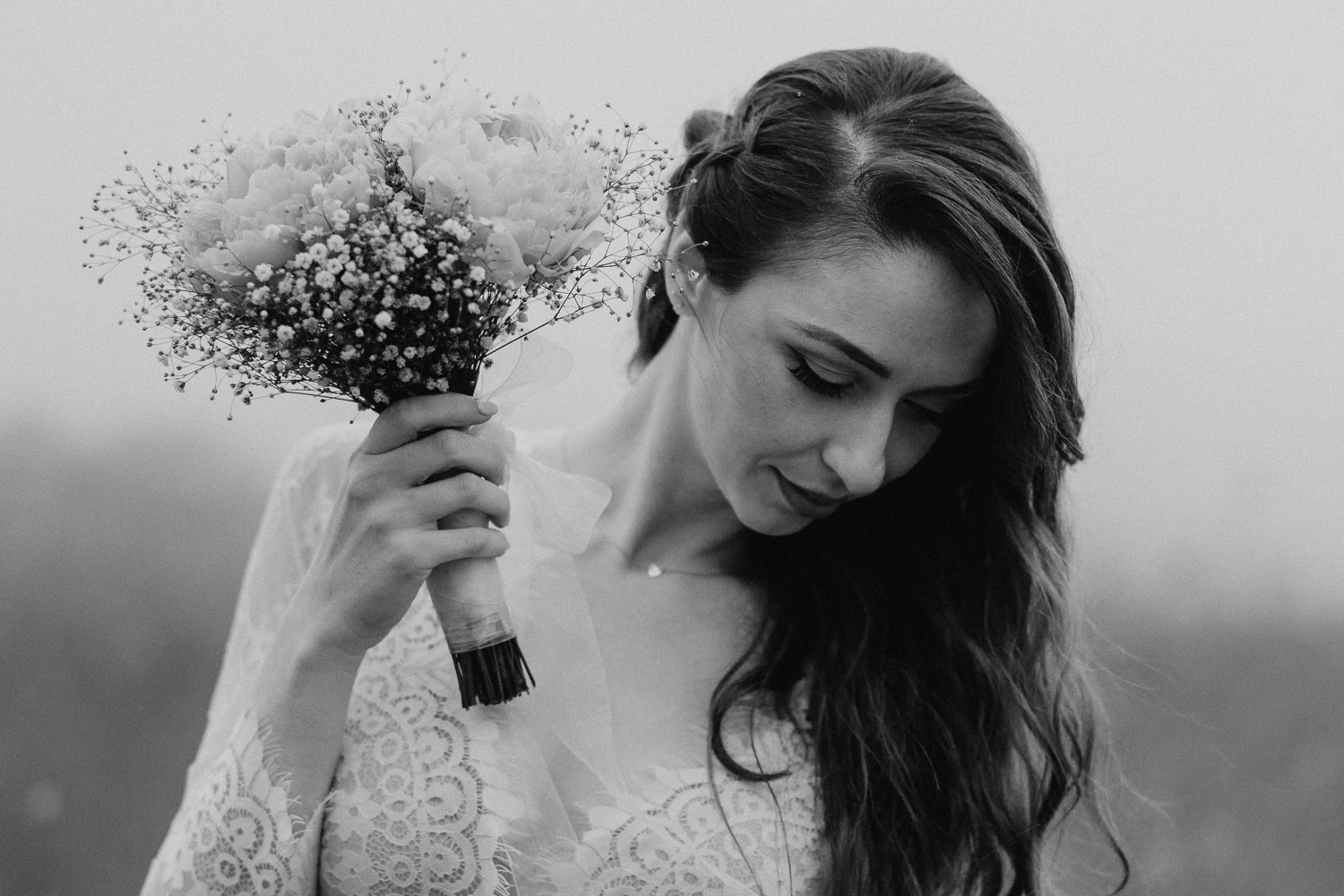 Black and White image of bride looks down