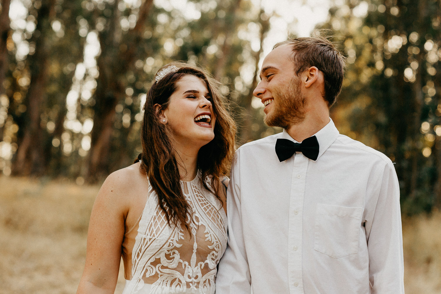 Image of bride and groom laugh together