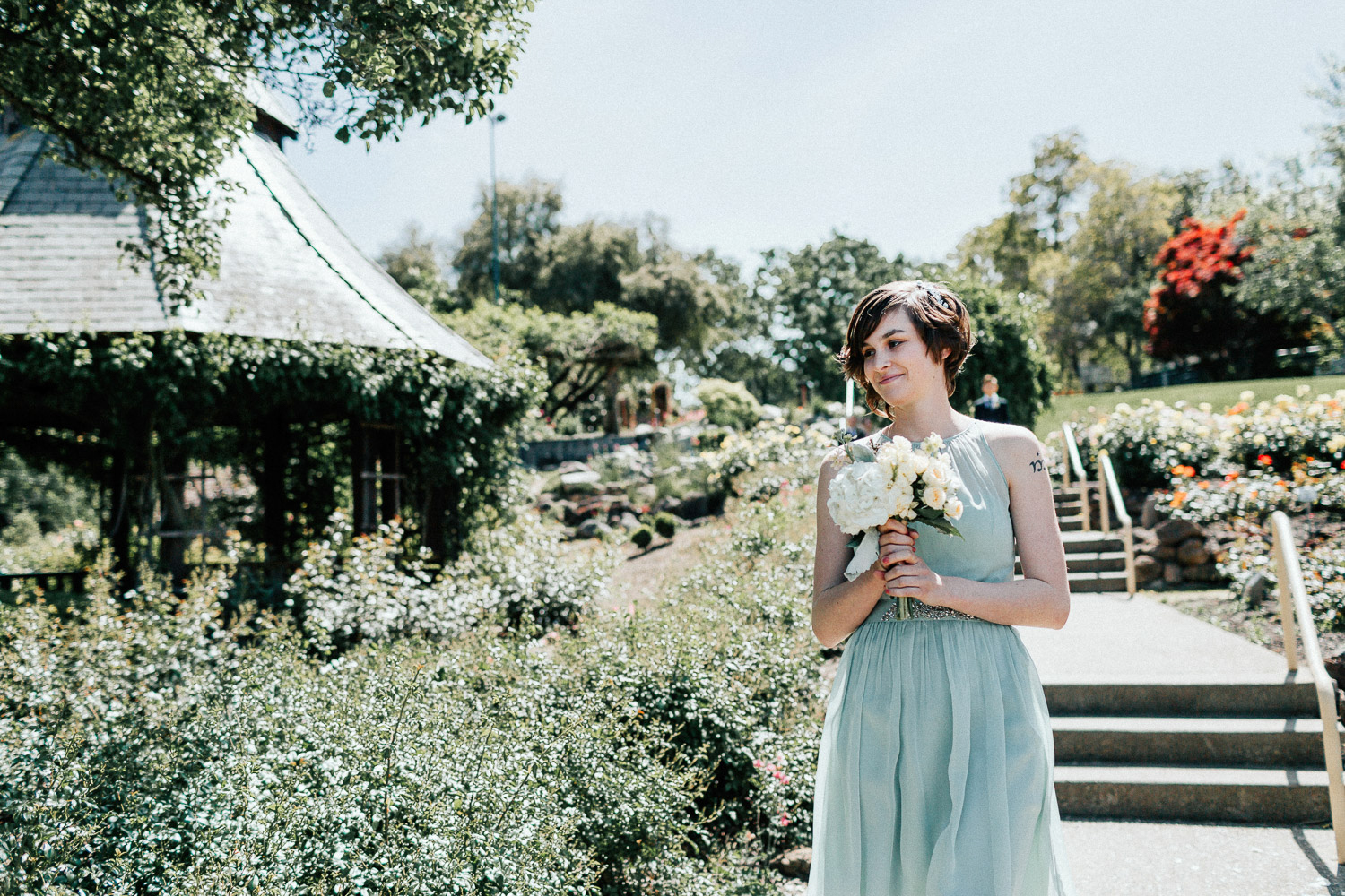 Image of maid of honor walk down the aisle