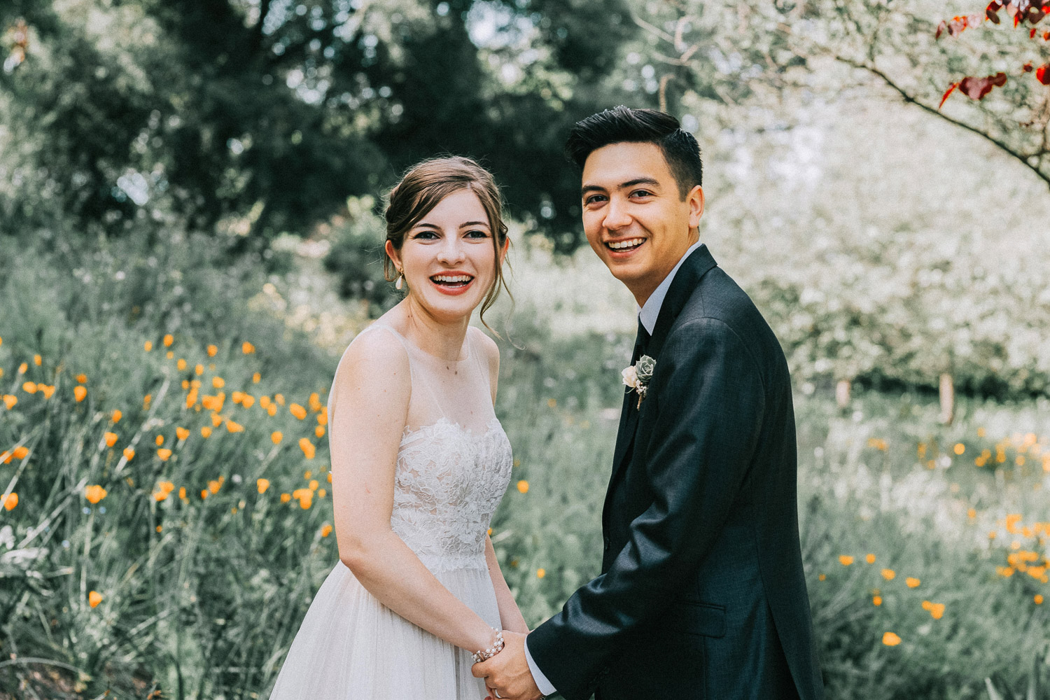 Image of bride and groom both smile