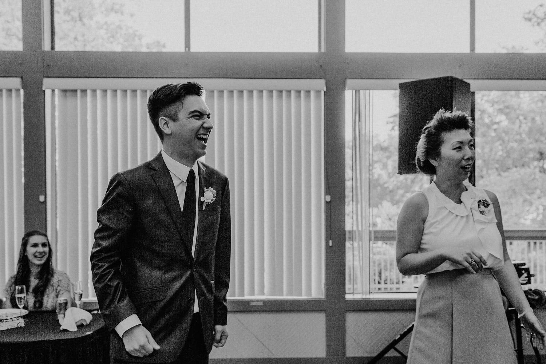Image of groom laugh on recepetion