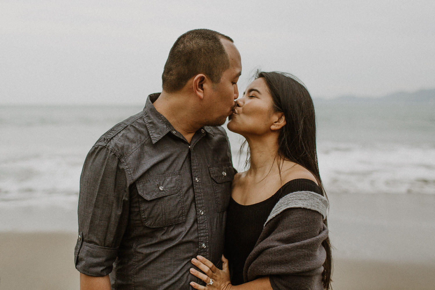 Image of Asian Couple Kisses Each Other