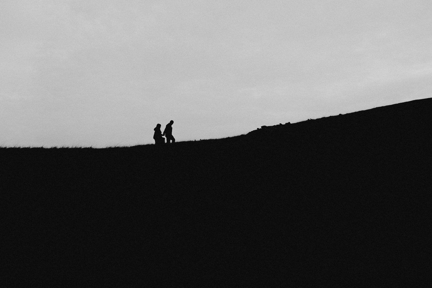 Image of Couple Walks Together on Top of the Hill