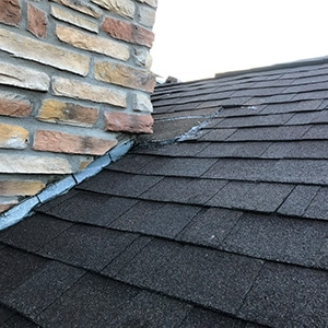 Roof Repair - Castle Rock Ice Damm next to Chimney