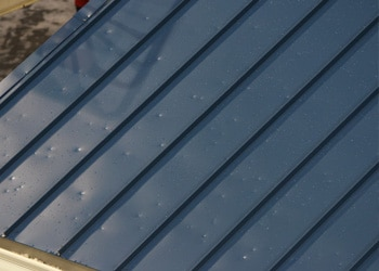 Hennessey Roofing offers free roofing inspections and estimates to repair this hail damage