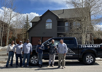 Hennessey Roofing Crew Posing outside of another great job